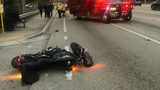 Motorcycle crash sends driver and pedestrian to hospital