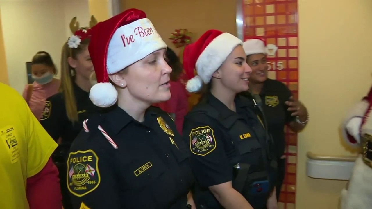 Video thumbnail for Officers bring Christmas to patients at Joe Dimaggio Children's Hospital