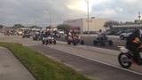 Wheels Up, Guns Down riders speed through Pembroke Park