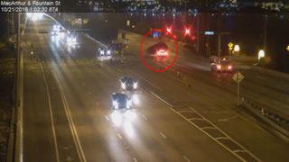 Surveillance video shows Tesla running red light before major crash