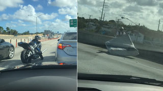 VIDEO: Motorcyclist clears away danger, moves mattress off I-95