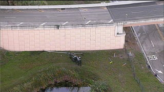 Pickup truck falls from Dolphin Expressway off-ramp
