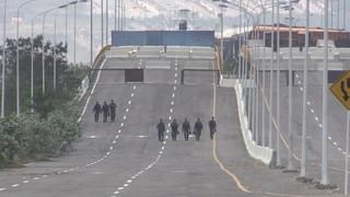 Concrete barricades reinforce bridge blockage during Hands Off Venezuela concert