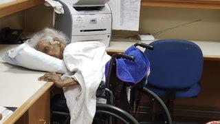Relatives find elderly family member alone, slumped over desk in nursing home
