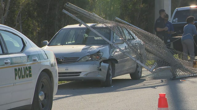 Naked man in custody after crashing truck into gate, fleeing into marsh