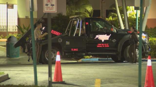 Repo man shot while sitting in tow truck