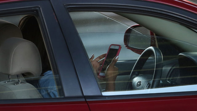 Put your phone down while driving: New texting law in effect