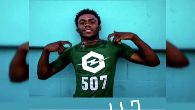 Rising football star fatally shot during dispute about video game, mother says