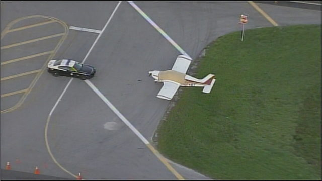 Small plane remains on side of highway after emergency landing