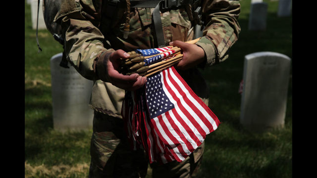 Photos: Soldiers adorn graves at Arlington National Cemetery with U.S. flags