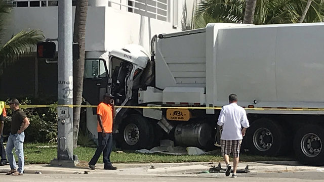 Garbage truck slams into building in South Miami