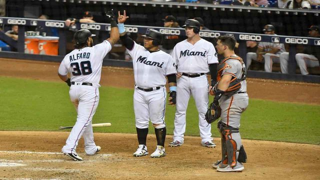 Alfaro, Cooper help Marlins romp Giants 11-3