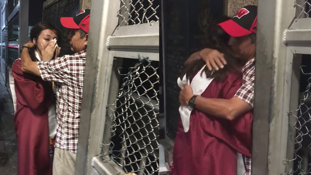 Graduate celebrates by hugging father at Mexican border