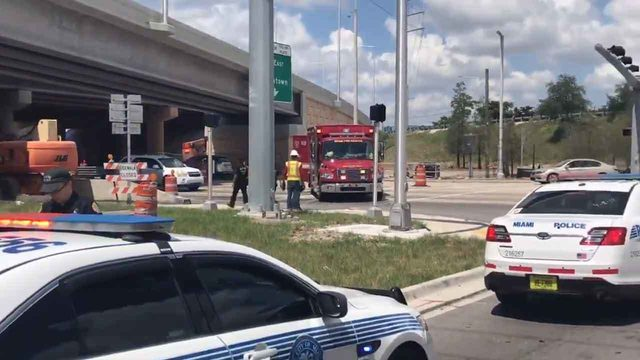 Man jumps off Dolphin Expressway overpass, lands on car