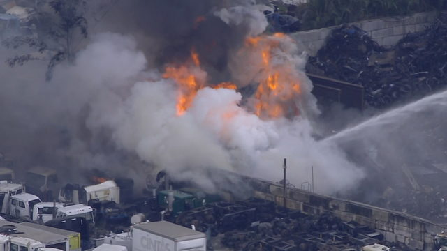 Large fire erupts at junkyard in Opa-locka