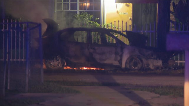 Car catches fire outside northwest Miami-Dade County home