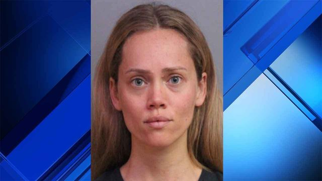 Florida woman arrested after giving husband's guns to police