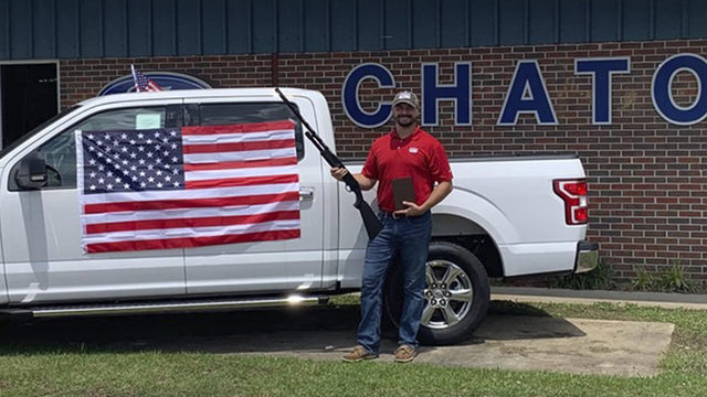 Car dealership gives away American flags, bibles and shotguns with each purchase