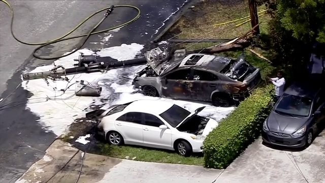 2 cars catch fire after 18-wheeler strikes powerlines in Pompano Beach
