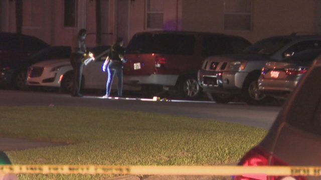 Woman shot while sitting inside vehicle in northwest Miami-Dade