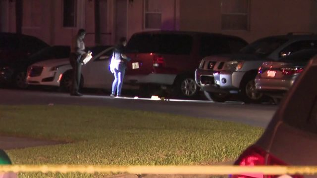 Woman in critical condition after being shot while sitting in vehicle