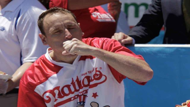 Joey Chestnut eats 71 hot dogs to secure 12th title
