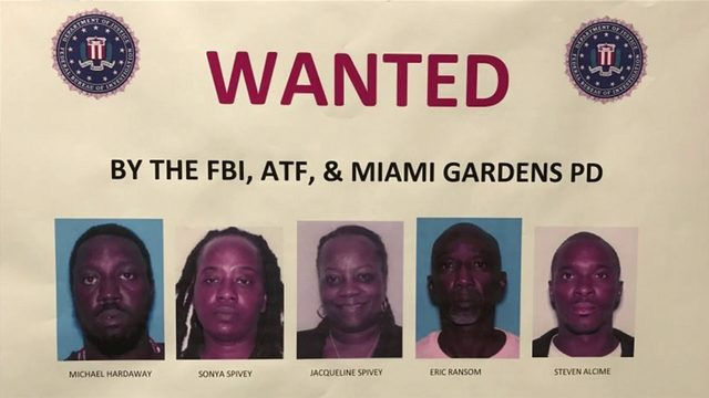 FBI agents search for 5 suspected gang members