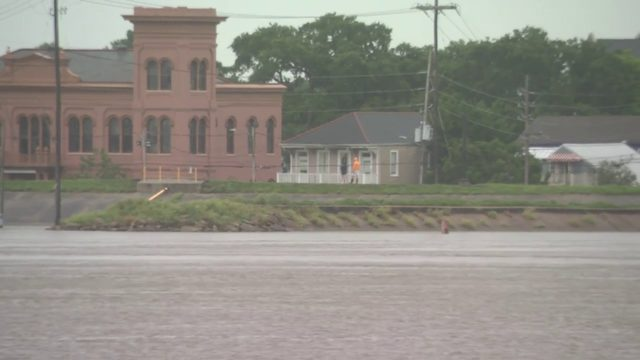 Barry makes landfall as rain continues to fall