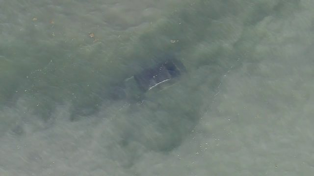 Car crashes into Biscayne Bay after blowing through barricade