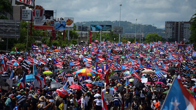 Protesters block main highway in San Juan with '#RickyRenuncia' signs