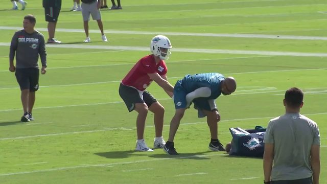 Dolphins open training camp for first time under Flores