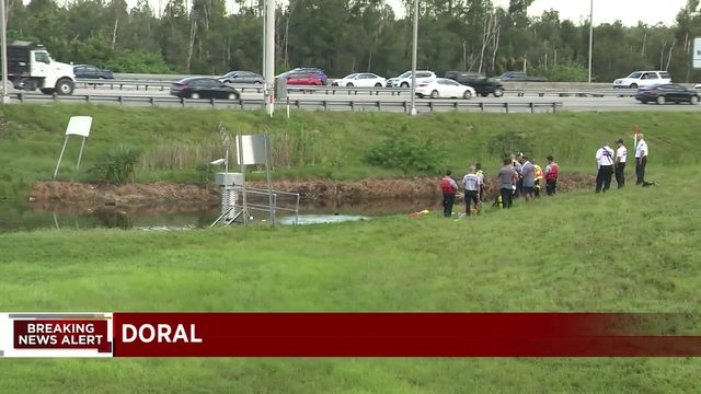 Divers pull man from canal in Doral