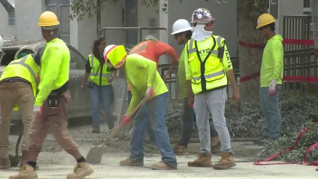 Work back underway after wet concrete spills onto cars near construction site