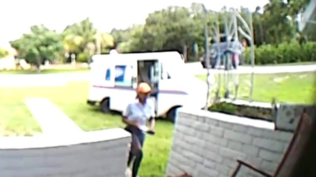 USPS mail carrier caught on camera driving over front lawn of home