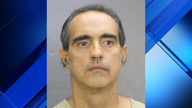 Man accused of sitting naked outside neighbor's apartment in Davie