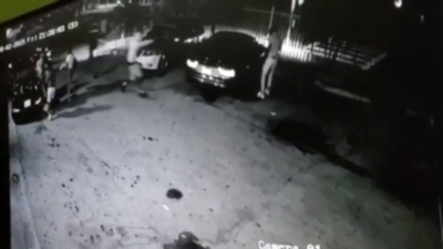Surveillance video shows 2 robbers targeting couple outside restaurant