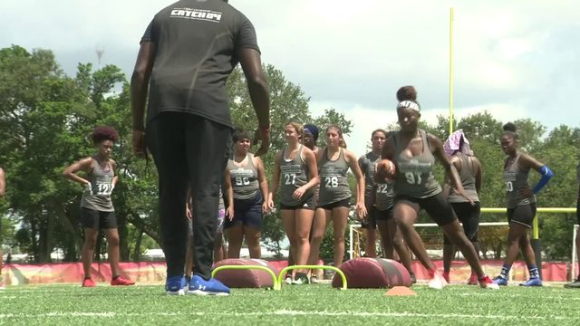 Dolphins player coaches female football camp