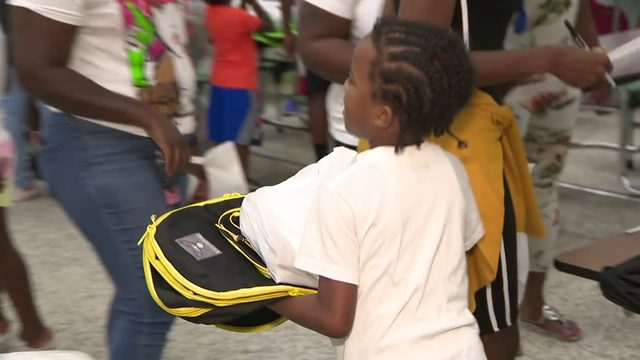 Police officers host back-to-school party for Liberty City students