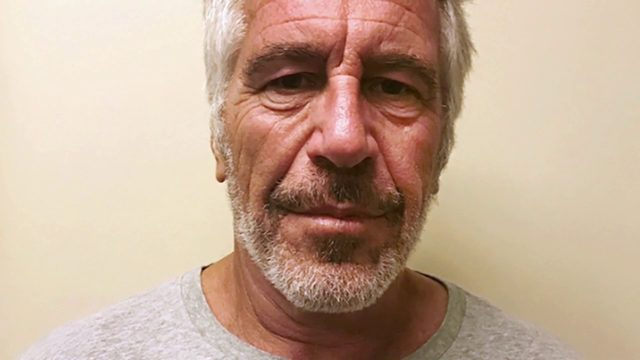 2 guards suspended and warden reassigned after Epstein death