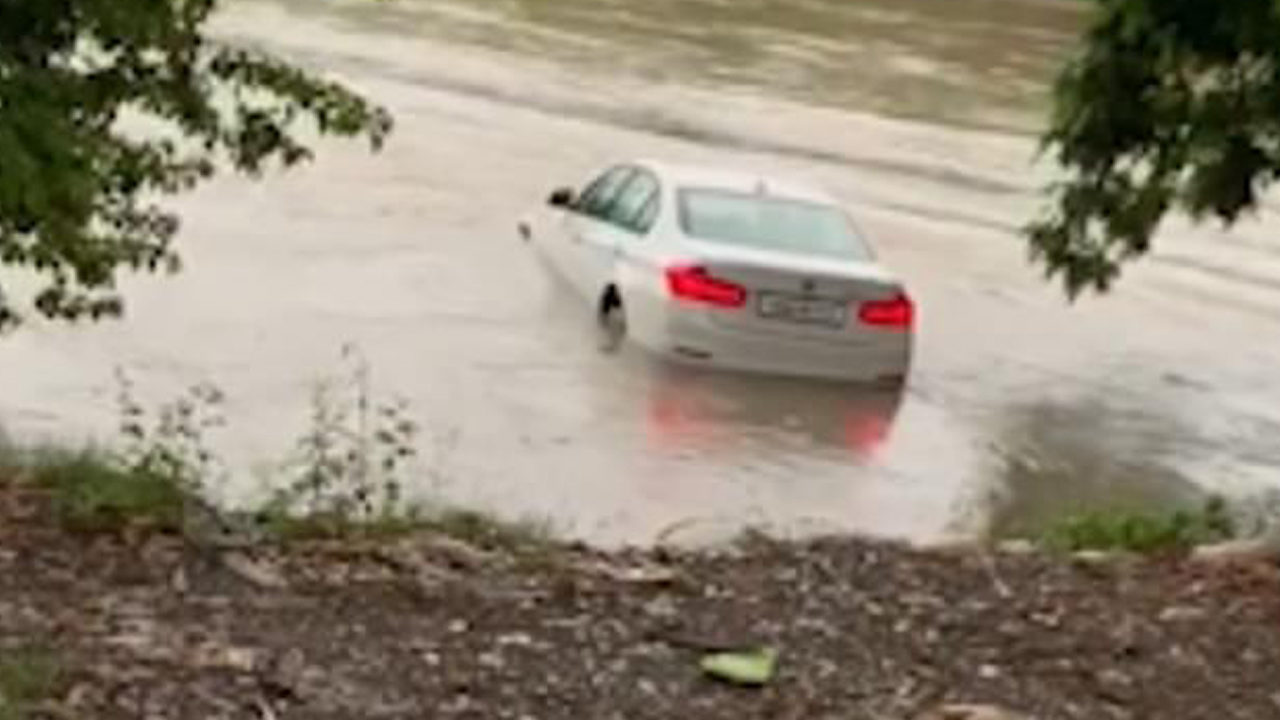 Ungrateful son pushes parents' BMW gift into river because he