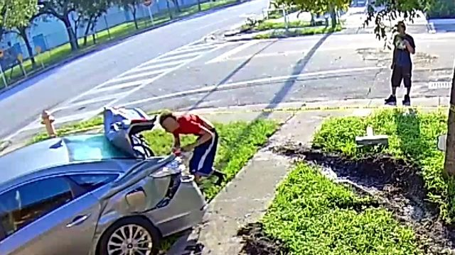 Surveillance videos shows burglars targeting crashed car in Miami-Dade