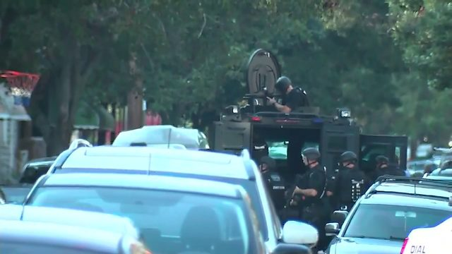 Gunman wounds at least 6 police; 2 others freed