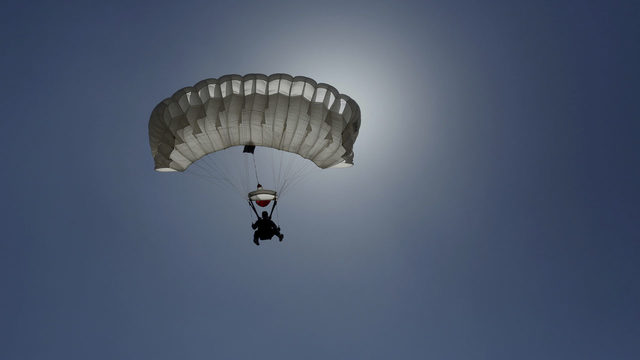 Woman survives plunge of more than 5,000 feet after parachute fails