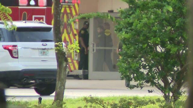 Wounded officer remains at Broward Health North