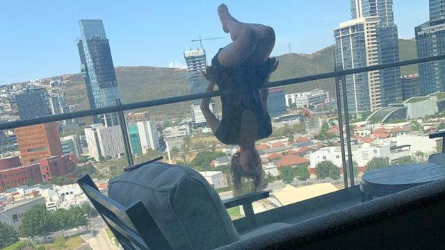 Student practicing yoga on balcony falls six floors