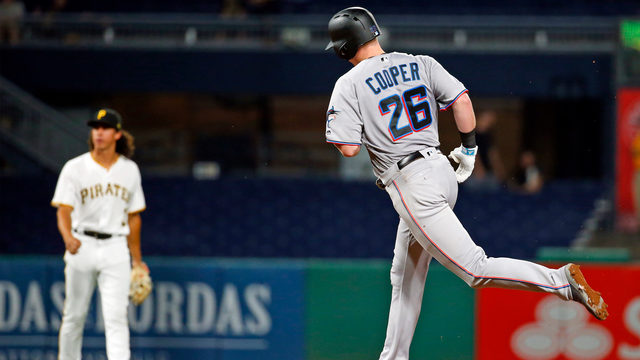 Late homers by Rojas, Cooper help Marlins end record road skid