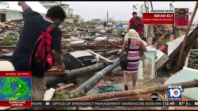 Crews work on clearing debris in Marsh Harbour to allow relief efforts in