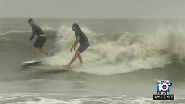 Surfers hit the water in Cocoa Beach after Dorian's outer bands pass through