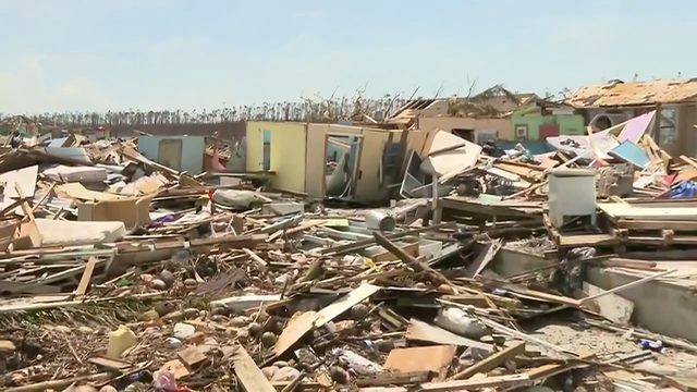 People continue to wait after Hurricane Dorian devastates Bahamas