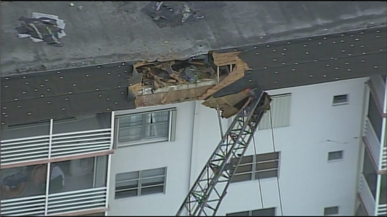 Crane collapses, damages roof of North Miami Beach condo building